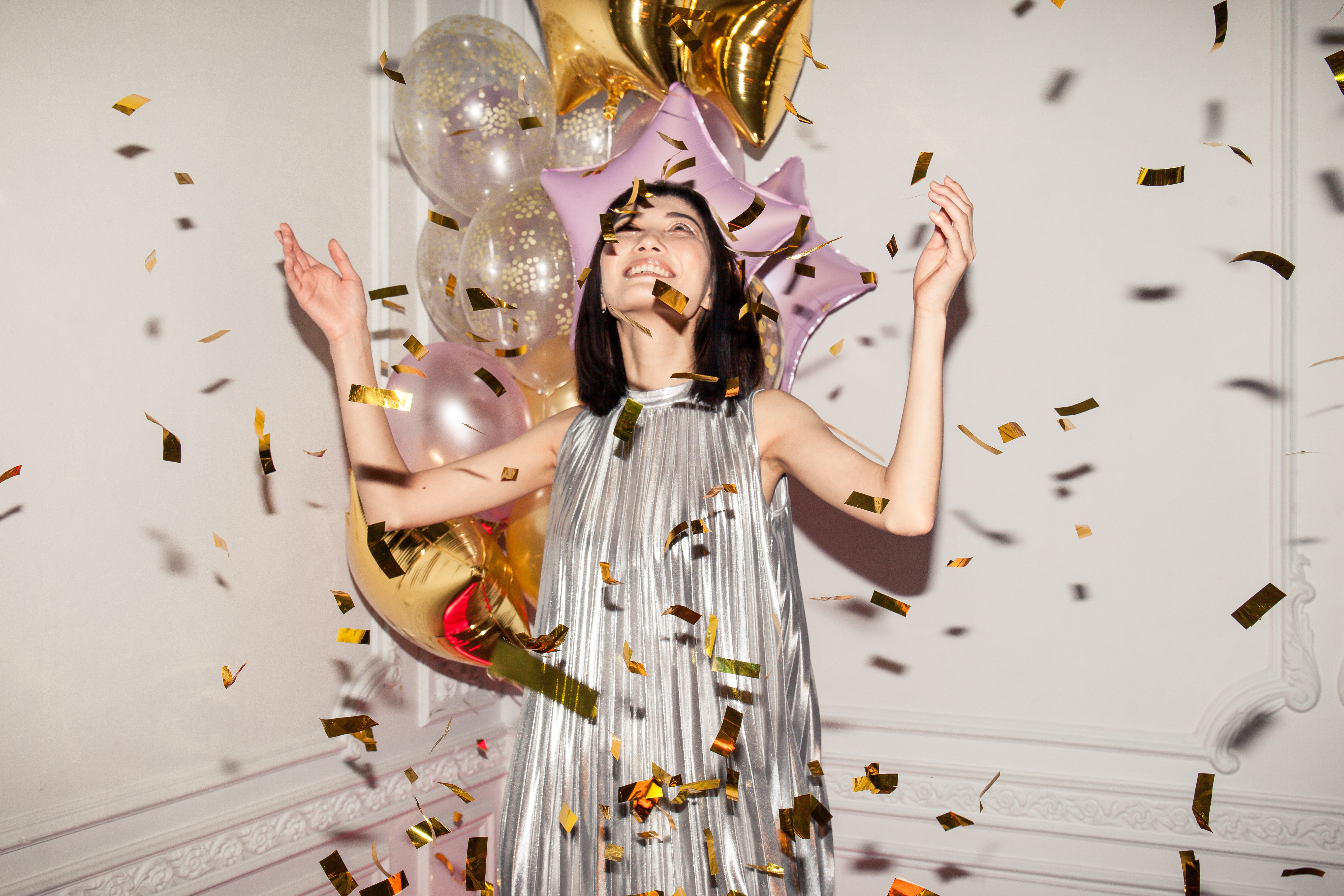 woman-looking-at-falling-confetti-3419692